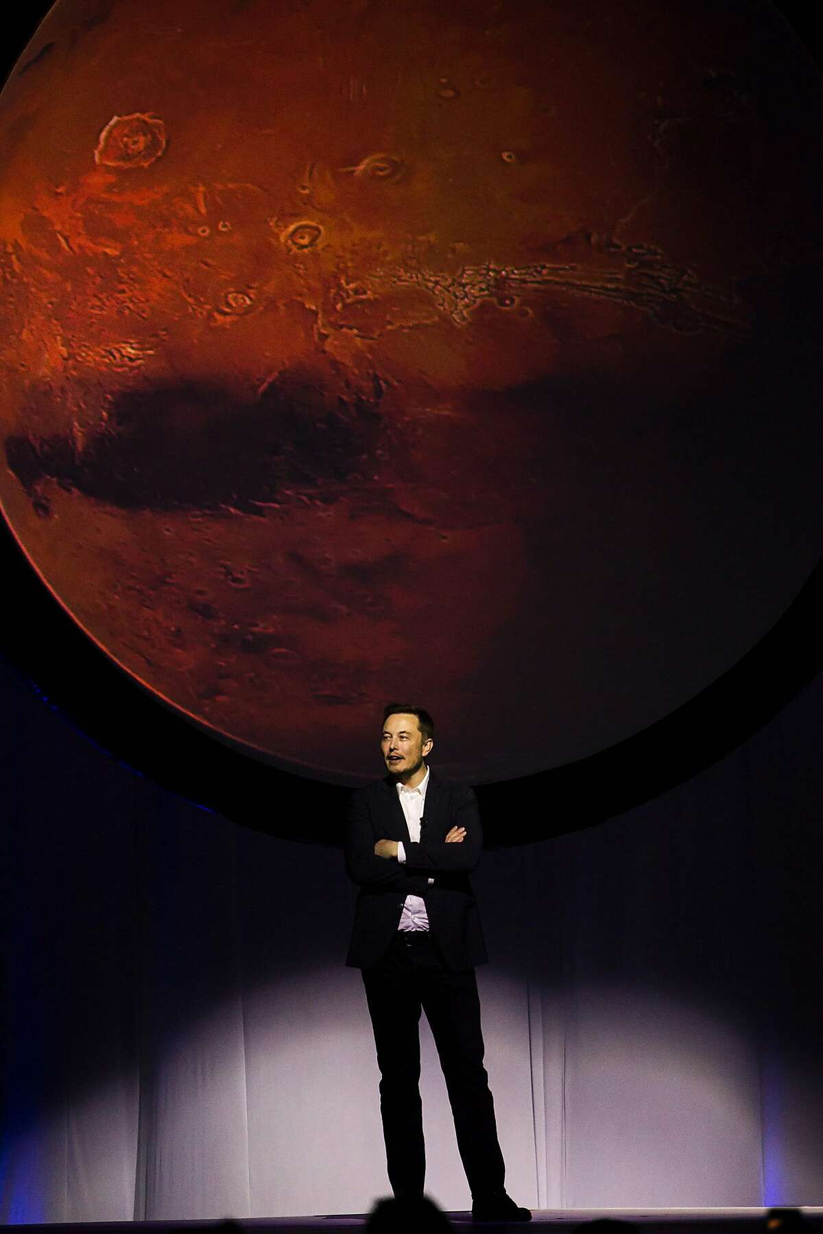 Tesla Motors CEO Elon Musk speaks about the Interplanetary Transport System which aims to reach Mars with the first human crew in history, in the conference he gave during the 67th International Astronautical Congress in Guadalajara, Mexico on September 27, 2016. / AFP PHOTO / Hector-GuerreroHECTOR-GUERRERO/AFP/Getty Images