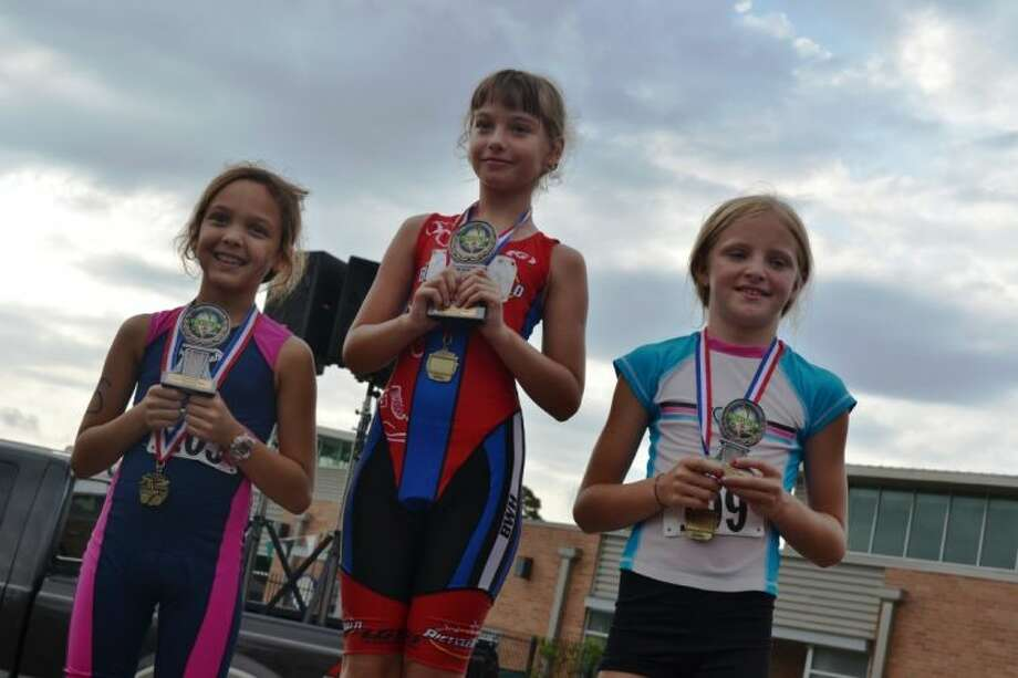 In the 9-year-old age group, First Place Winner was Olga Evtikhova, of Tomball, Second Place Winner was Daisy de Carlos, of Sweeney and Third Place Winner was Taylor Johnson, of The Woodlands. Each participated in the 2013 Kiwanis YMCA Kids Triathlon Saturday morning.