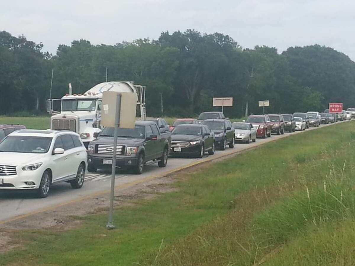 Afternoon traffic congestion on the I-10 West frontage road near FM 1463.