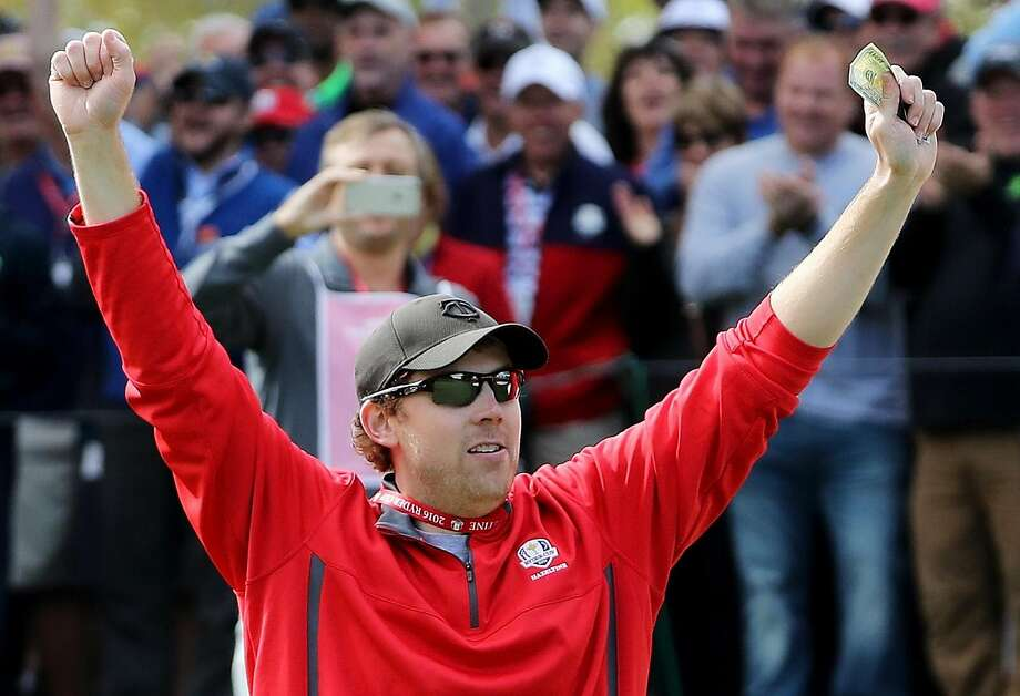 CHASKA, MN - SEPTEMBER 29:  Fan David Johnson of North Dakota reacts after being pulled from the crowd and making a putt on the eighth green during practice prior to the 2016 Ryder Cup at Hazeltine National Golf Club on September 29, 2016 in Chaska, Minnesota.  (Photo by David Cannon/Getty Images) Photo: David Cannon, Getty Images
