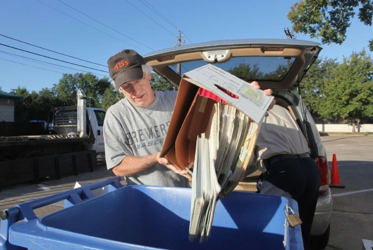 Bellaire resident Jim Richards unloads a box of paper to be shredded at the Bellaire Recycles Fest.