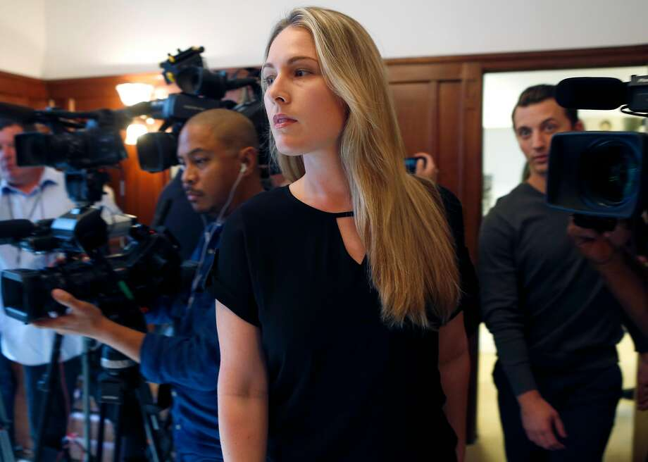 Denise Huskins and Aaron Quinn (right) walk into a news conference with attorney Doug Rappaport in San Francisco, Calif. on Thursday, Sept. 29, 2016. Huskins and Quinn were victims in the bizarre Vallejo kidnapping case in March 2015. Matthew Muller has pleaded guilty to kidnapping the couple. Photo: Paul Chinn, The Chronicle
