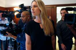 Denise Huskins and Aaron Quinn (right) walk into a news conference with attorney Doug Rappaport in San Francisco, Calif. on Thursday, Sept. 29, 2016. Huskins and Quinn were victims in the bizarre Vallejo kidnapping case in March 2015. Matthew Muller has pleaded guilty to kidnapping the couple.