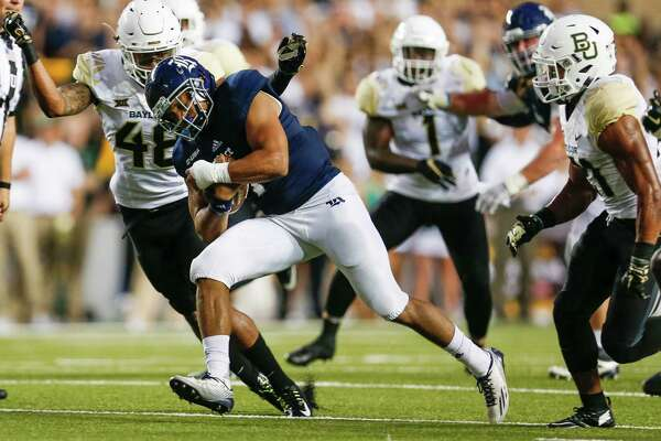 Rice running back Darik Dillard (1) is caught by Baylor defensive back Travon Blanchard (48) during the first quarter of an NCAA football game at Rice Stadium on Friday, Sept. 16, 2016, in Houston. ( Brett Coomer / Houston Chronicle )
