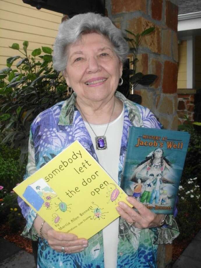 The Village at Gleannloch Farms resident Marcia Bennett shows the two books that will be translated into American Sign Language and videoed for students at the Texas School for the Deaf in Austin.