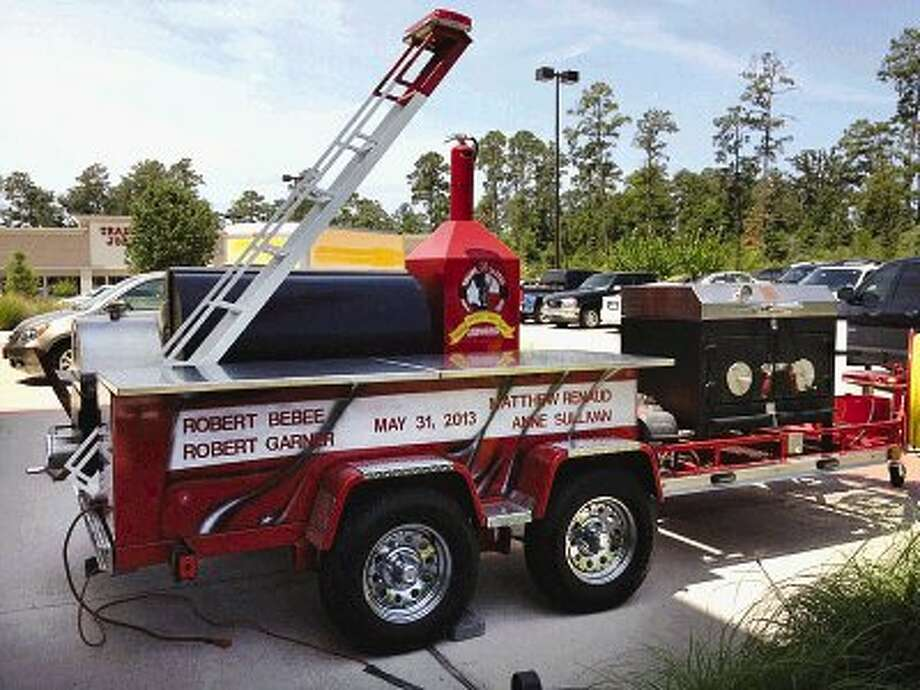 A custom firefighter-themed barbecue pit from Pits & Spitts is being raffled off in support of the families of Houston firefighters killed in the line of duty earlier this year.