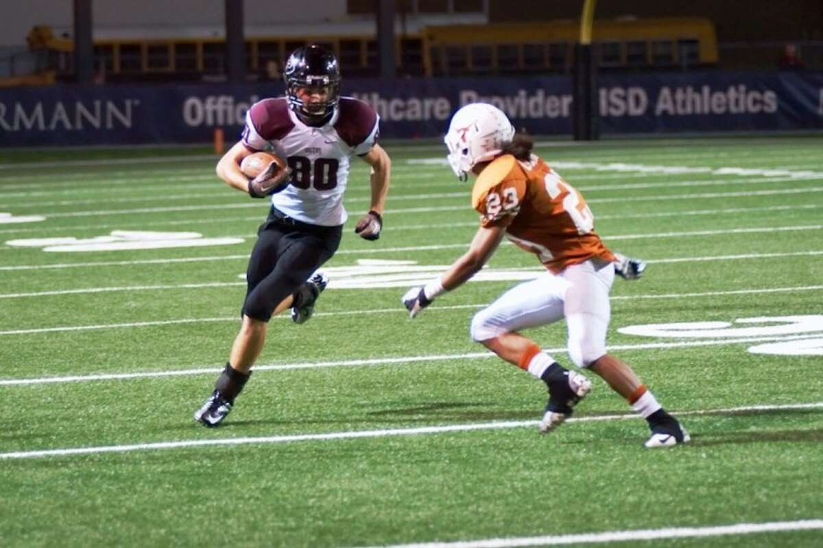 Pearland's Trey Smith looks to gain yardage after catching a pass in the third quarter Thursday night against Pasadena Dobie.