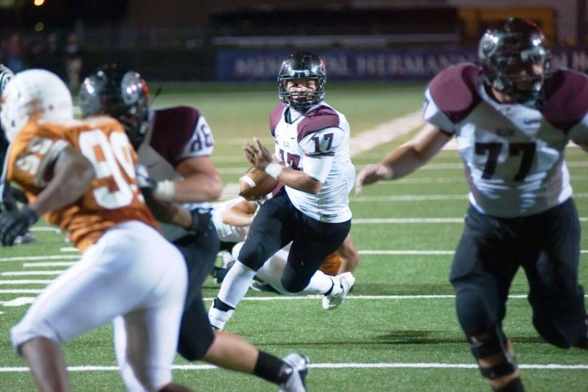 Pearland's Hayden Cole runs for yardage Thursday night against Pasadena Dobie. Cole scored twice in the Oilers' 42-0 victory in Pasadena.