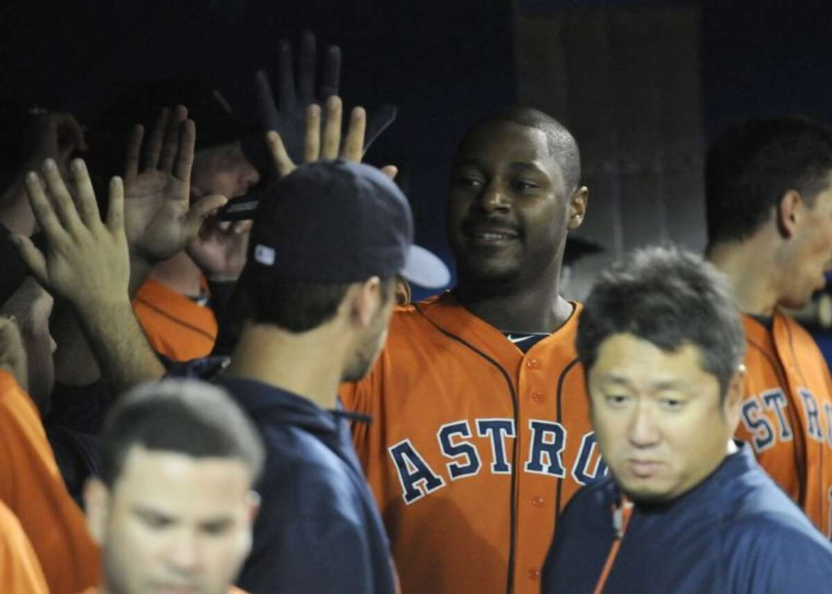 Houston Astros designated hitter Chris Carter high-fives teammates in the dugout after hitting a three-run home run in the first inning against the Toronto Blue Jays on Saturday in Toronto.