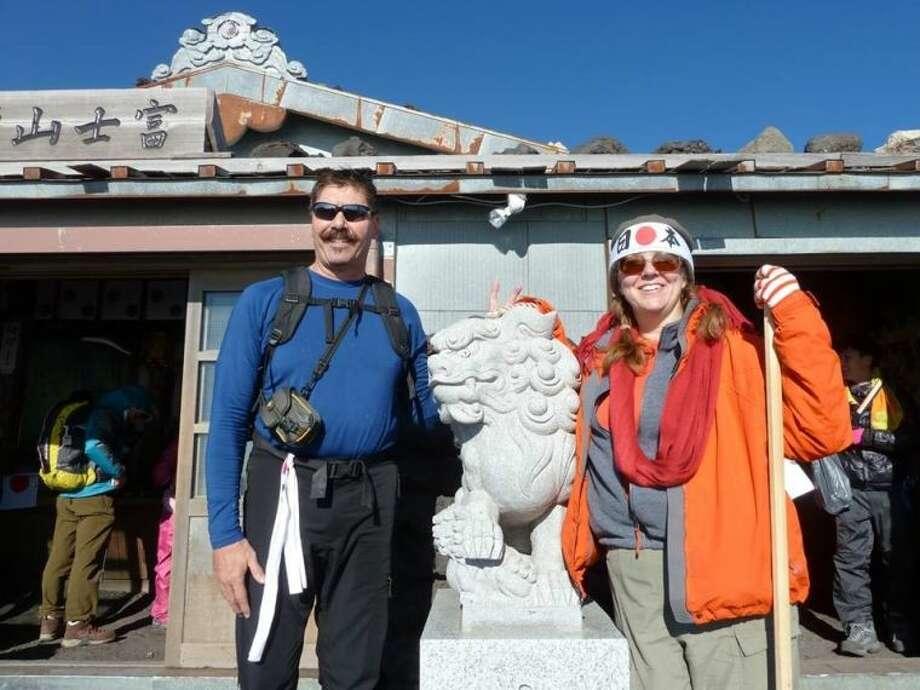 John and Shey Moniz on the summit of Mount Fuji.