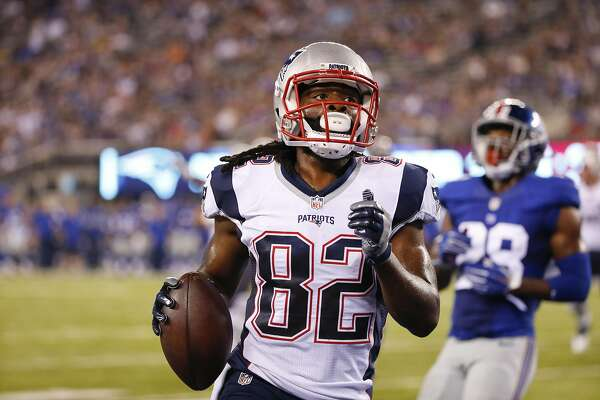 New England Patriots wide receiver Keshawn Martin (82) runs for a touchdown during the first half of a preseason NFL football game against the New York Giants Thursday, Sept. 1, 2016, in East Rutherford, N.J.  (AP Photo/Kathy Willens)