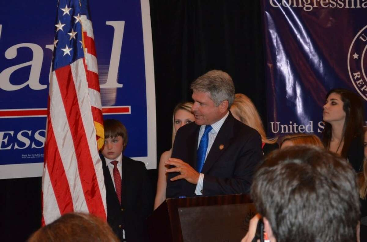 Congressman Michael McCaul, surrounded by his family, addresses a crowd after winning election to his fifth term in the United States House of Representatives. Submitted photo