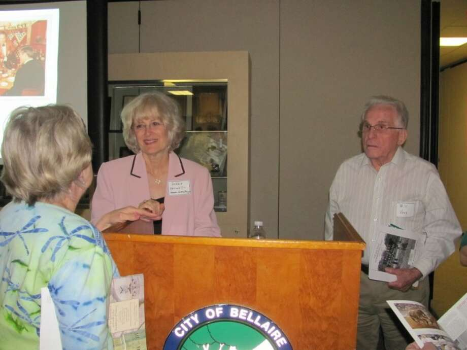 """Dr. Debbie Harwell, center, speaks with Nancy Manning Reese, left, and Bill Voss at a recent meeting of the Bellaire Historical Society. Harwell teaches history at the University of Houston and is managing editor of """"Houston History"""" magazine, a publication of the UH History Department's Center for Public History."""