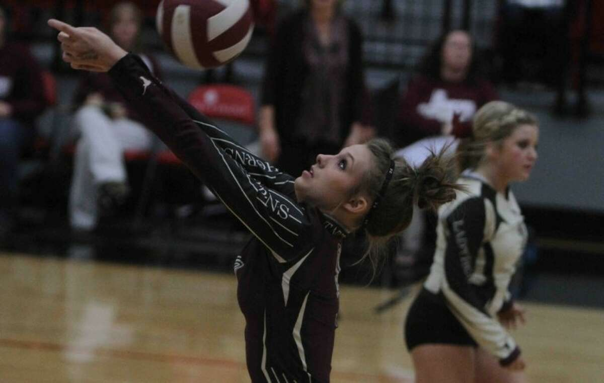 Tarkington's Erica Lott (9) hits the ball over the net during the Region III quarterfinal volleyball game at Lee College on Nov. 6, 2012.