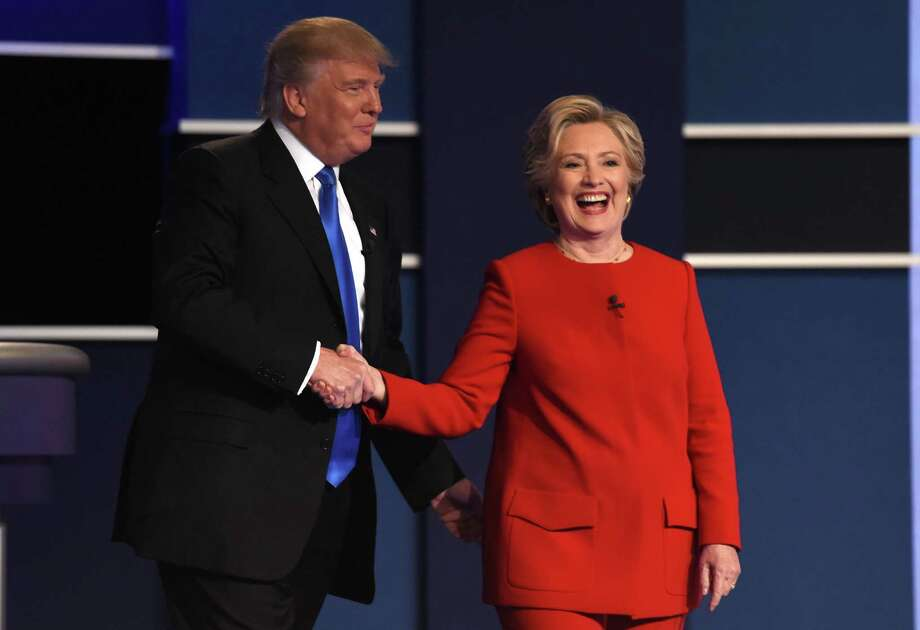 Democratic nominee Hillary Clinton shakes hands with Republican nominee Donald Trump after the first presidential debate earlier this week. The candidates discussed global warming, national security and President Obama's birth certificates, but it was their hairstyles that intrigued one of our readers. Photo: TIMOTHY A. CLARY /AFP /Getty Images / AFP or licensors