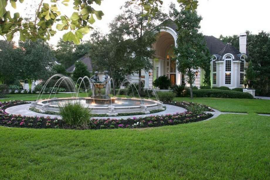 The front view of The Blair House showcases a large fountain as part of the property's many amenities.