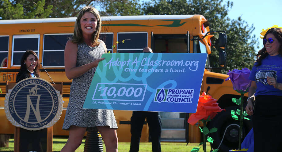 Jenna Bush Hager, daughter of former U.S. President George W. Bush, presents a $10,000 check to teachers at J.B. Passmore Elementary School Thursday September 29, 2016. Bush Hager visited the school in the Northside Independent School District on behalf of the Propane Education and Research Council. In recognition of the district's use of propane powered school buses, Bush Hager surprised teachers there with the check to be used for school supplies. Photo: John Davenport, Staff / San Antonio Express-News / ©San Antonio Express-News/John Davenport
