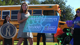 Jenna Bush Hager, daughter of former U.S. President George W. Bush, presents a $10,000 check to teachers at J.B. Passmore Elementary School Thursday September 29, 2016. Bush Hager visited the school in the Northside Independent School District on behalf of the Propane Education and Research Council. In recognition of the district's use of propane powered school buses, Bush Hager surprised teachers there with the check to be used for school supplies.