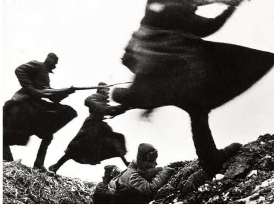 "Dmitri Baltermants, Attack—Eastern Front WWII,1941, gelatin silver print, printed 1960, the MFAH,gift of Michael Poulos in honor of Mary Kay Poulosat ""One Great Night in November, 1997."" © Russian Photo Association, Razumberg Emil Anasovich."