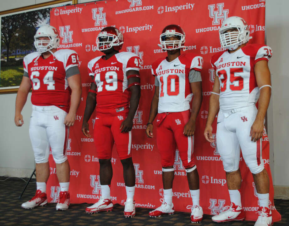 Ty Cloud, Kenneth Farrow, Derrick Mathews and Zach McMillian display the University of Houston football team's home, away and alternate uniforms for the 2013 season.