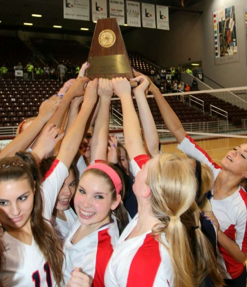 The Clear Lake volleyball team raises the Regional trophy after the win against Clear Falls. Photo: Kar B Hlava
