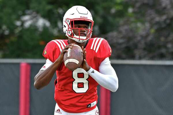 University of Louisville sophomore quarterback Lamar Jackson warms up before the start of the team's morning practice at the Louisville practice facility, Tuesday, Aug. 16, 2016 in Louisville Ky. (AP Photo/Timothy D. Easley)