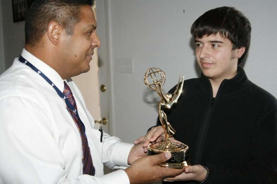 Roger Franco, left, journalist with Telemundo, spends time and displays his Emmy with Kingwood teen Michael Leon, who was the inspiration for a two-part story about Leon's need for a second heart transplant.
