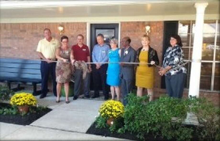 Board Chairman Angie Borges and Board members, joined by PRMC Medical Director Dr. Funsho Fagbohun, Exec. Director, Tama Chunn and Nurse Mgr. Nan Haskins cut the ribbon on the Pregnancy Resource Medical Center Photo: Submitted Photo