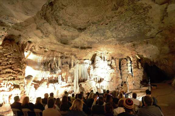 People listen to a performance by the musical group Kazemon at the Cave Without A Name near Boerne in 2013.