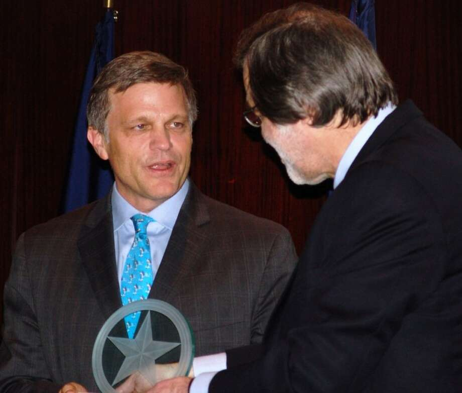 "Rice University Professor and author Dr. Douglas Brinkley (left) receives the ""San Jacinto Star"" award from San Jacinto Museum President Larry Spasic."