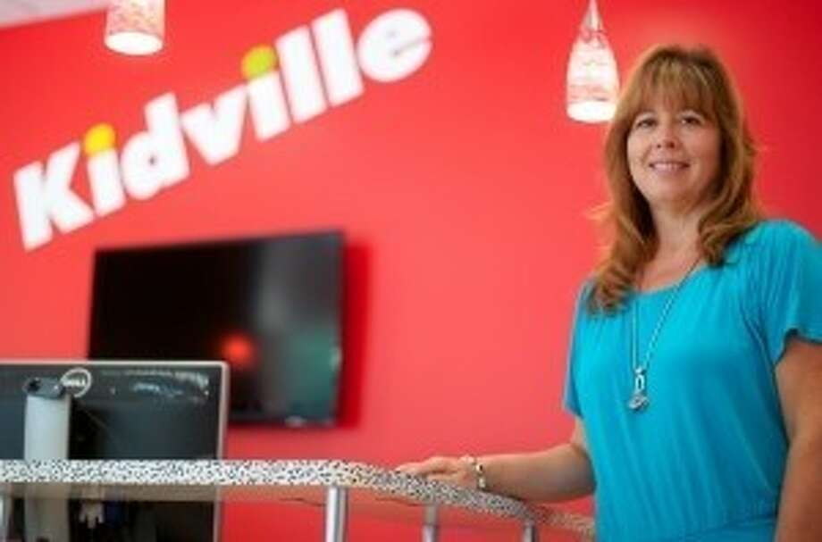 Karen Roberts, owner/director of Kidville-The Woodlands, is hoping to help the Montgomery County Food Bank provide more food for needy children.