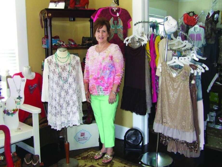 Daphney Skelton, owner of Daphney's Boutique in Magnolia, shows off some of the clothing available in her store. The store is located at 119 Magnolia Blvd.