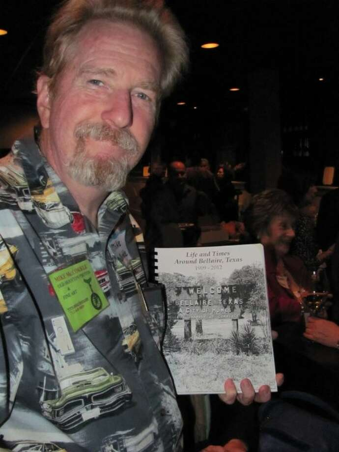 "Mike McCorkle with a copy of his book, ""Life and Times Around Bellaire, Texas, 1909-2013,"" a must-have for local history buffs. The book is self-published and printed on demand. Copies will be available at a book-signing event planned for 6 p.m. Saturday, Dec. 7, at McHughTea, 5305 Bissonnet, Suite D."
