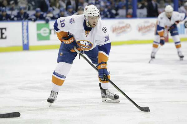 New York Islanders center Alan Quine (10) waits for the puck during the first period of Game 2 of the NHL hockey Stanley Cup Eastern Conference semifinals Saturday, April 30, 2016, in Tampa, Fla. (AP Photo/Chris O'Meara)