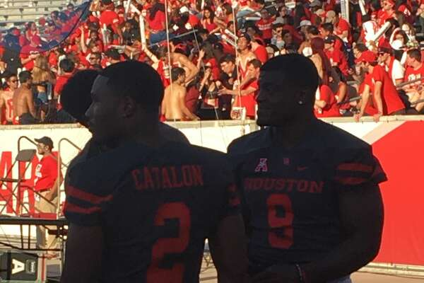 UH running back Duke Catalon and linebacker Matthew Adams (right) missed Thursday's game against Connecticut at TDECU Stadium.