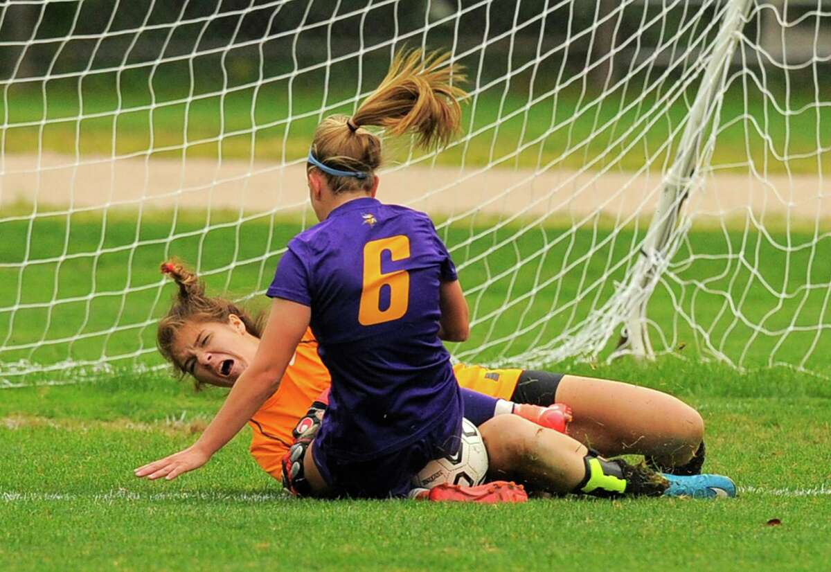 New Canaan goalie Kendall Curtin crashes into Westhill Corrine Dente to make a second half save in a varsity girls soccer match at Conner Field in New Canaan, Conn. on Thursday, Sept. 29, 2016. Westhill and New Canaan played to a 1-1 tie.