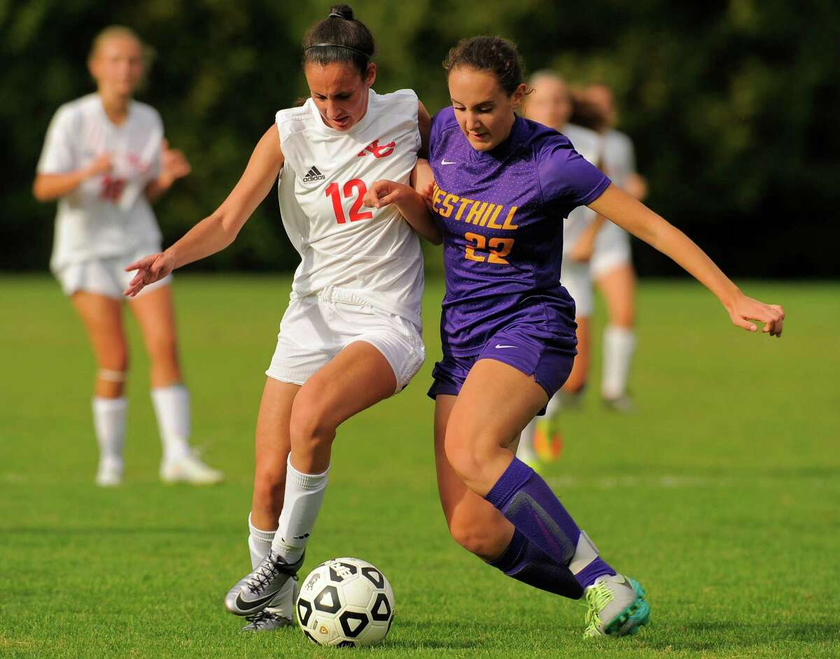 New Canaan Madison Starr and Westhill Erica Shaulson battle for the ball in a varsity girls soccer match at Conner Field in New Canaan, Conn. on Thursday, Sept. 29, 2016. Westhill and New Canaan played to a 1-1 tie.