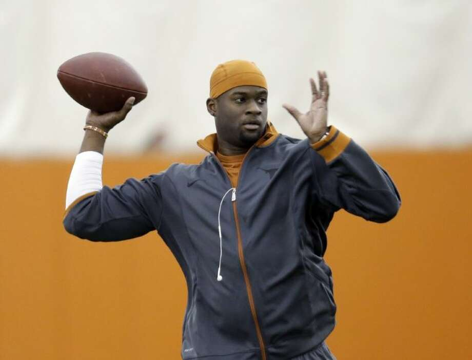 Former University of Texas quarterback Vince Young throws during the Longhorns' pro day last year in Austin.