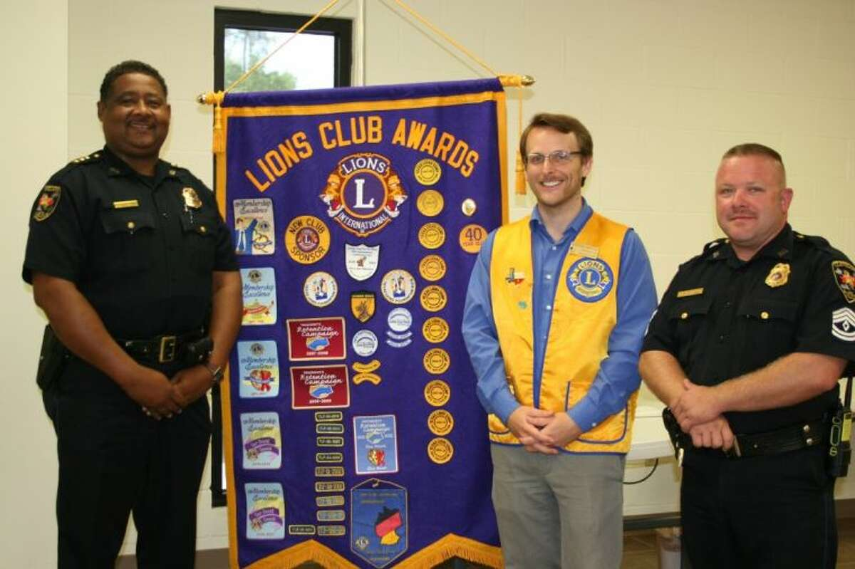 During the Aug. 6 meeting of the Cleveland Lions Club, Chief Darrel Broussard and Sgt. Paul Lowrey were present to provide information regarding the department's support of red-light cameras. Lions Club President Taylor Heilers (center) was on hand to welcome them.