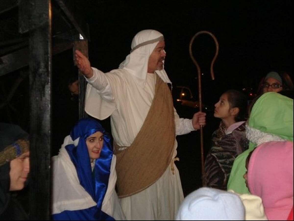 Bill Bechtel, portrays a shepherd to tell the Christmas story to just one group of more than 600 visitors who attended Bellaire United Methodist Church's
