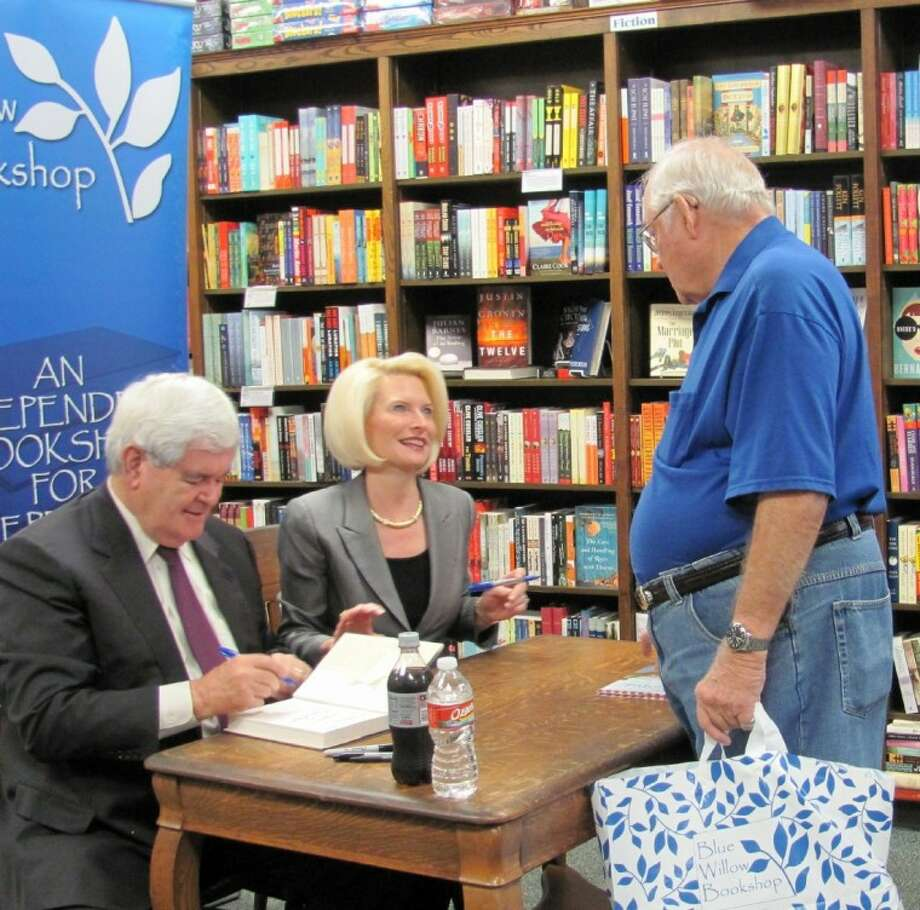 Newt and Callista Gingrich sign copies of their new books for Delman Perkins at Blue Willow Bookshop on Nov. 20. Perkins, who lives in the Galleria area, is an avid reader of history and was excited to add to his extensive collection of signed books.