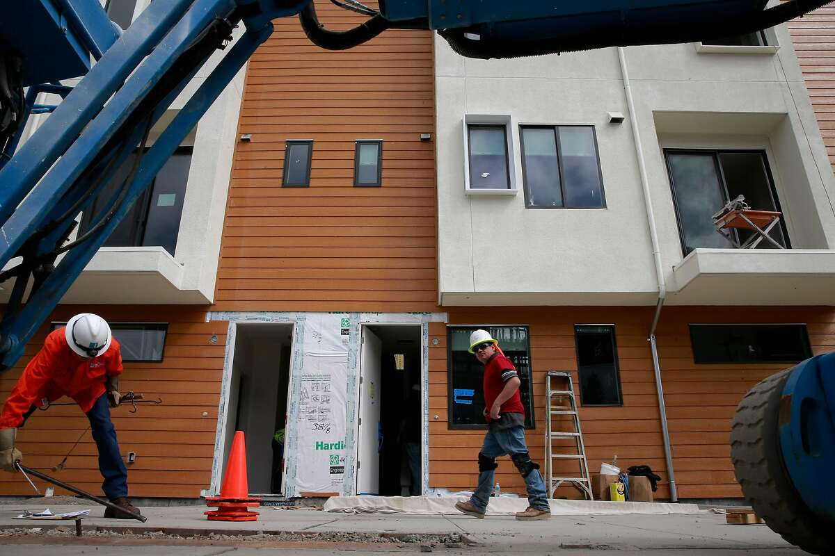 Construction continues at the Station House development where homes are priced starting at $600,000 in West Oakland, California as seen on Thurs. Sept. 29, 2016.