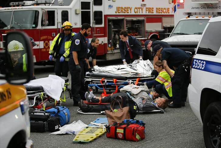 NEW YORK, NY - SEPTEMBER 29:  People are treated for their injuries outside after a NJ Transit train crashed in to the platform at Hoboken Terminal September 29, 2016 in Hoboken, New Jersey. Dozens are reported injured from the rush hour accident in the terminal that handles up to 50,000 passengers a day.   (Photo by Eduardo Munoz Alvarez/Getty Images)