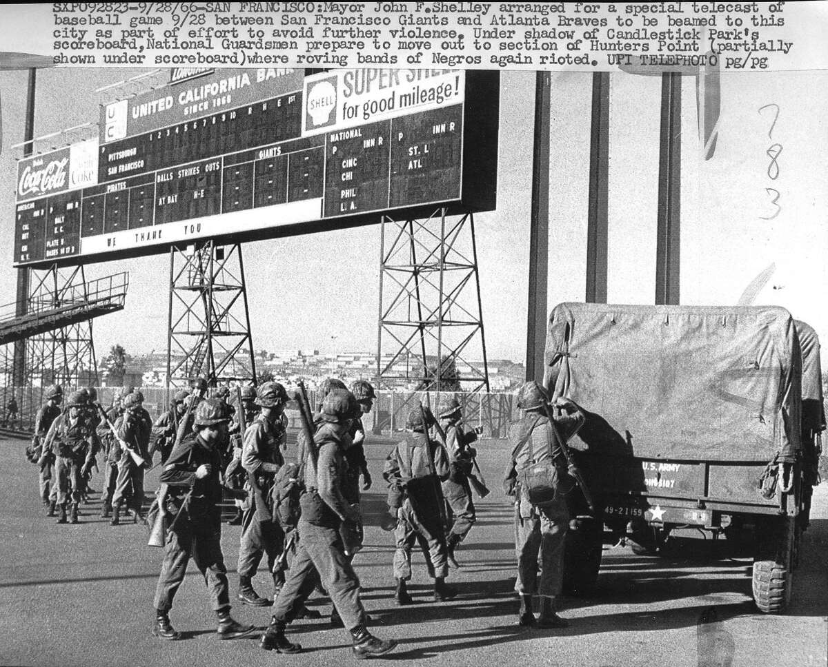 """On September 27, 1966 a riot broke out in San Francisco's Hunters Point, a black neighborhood, when a white police officer shot and killed an unarmed seventeen-year-old African American, Matthew Johnson, Jr., as he fled the scene of a stolen car. Disturbances broke for several days in different parts of the city. """"Under shadow of Candlestick Park's scoreboard, National Guardsmen prepare to move out to section of Hunters Point."""" Ran: Sep 29 1966, p. 20B, UPI photo."""