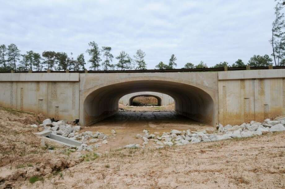 The photos shows a view of a pedestrian underpass currently under construction on Springwoods Village Parkway that will allow pedestrians the ability to walk or bike across the community, free of traffic activity.