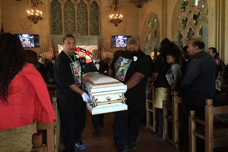 Family members carried the casket of 2-year-old Jeremiah Leonidas Esera out of the Chapel of the Chimes in Oakland following the little boys funeral Friday.