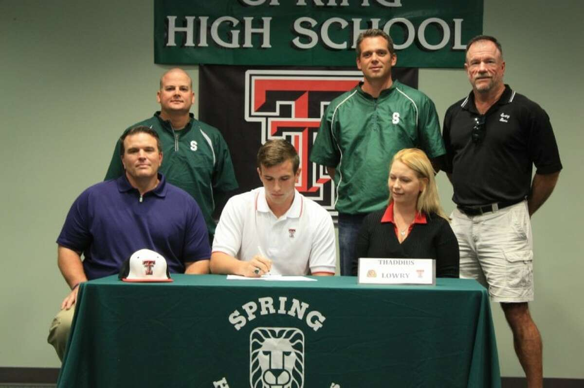Spring pitcher Thaddius Lowry (center) signs a letter of intent to play for Texas Tech University. Sitting next to him are his father Thomas and mother Kelly. In the back row (from left to right) are assistant coach Jeremy Willis, coach Kyle Humphreys and assistant coach Mike Farmer.