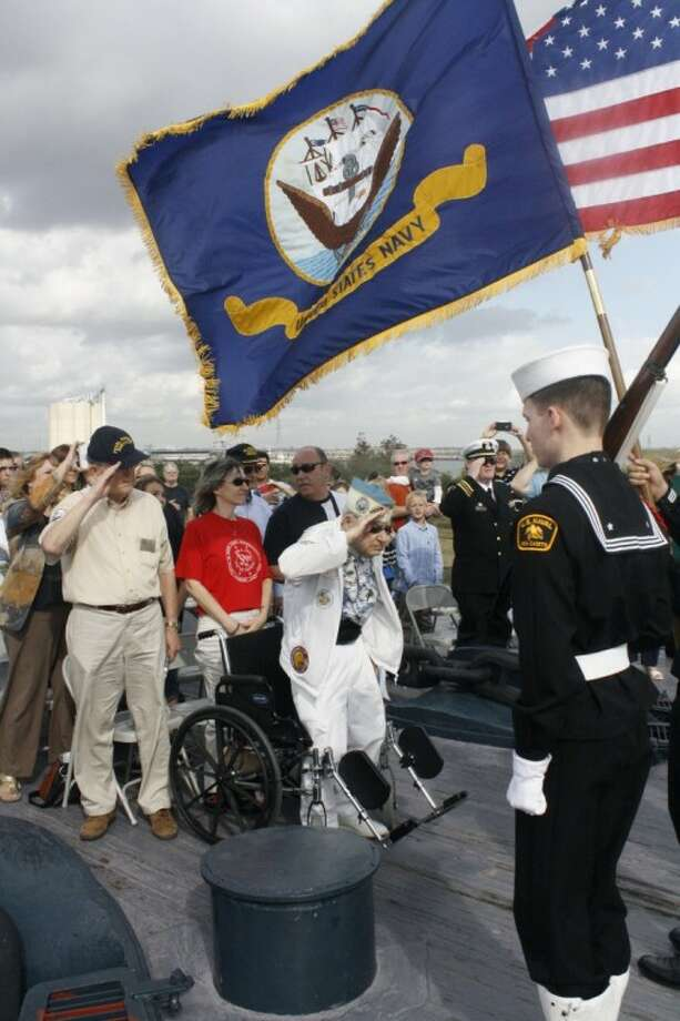 Pearl Harbor survivor Lewis Lagesse salutes the American flag during a Pearl Harbor remembrance ceremony held aboard the USS Texas on Dec. 1, 2012 Photo: LOUIS ROESCH