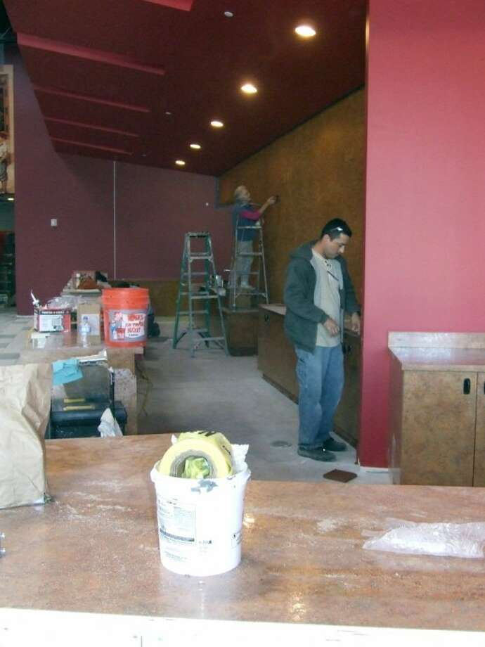 Construction crews work to put the last touches on the newly remodeled Premiere Cinema building at & Premiere Cinema readies to reopen doors in time for holidays ...