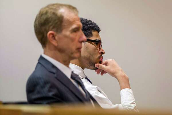 San Antonio, Texas -- September 29, 2016 -- Joshua Joyner, 17, sits with his attorney Mario A. Treviño during his trial in the Bexar County 386th Juvenile District Court. Ray Whitehouse / for the San Antonio Express-News